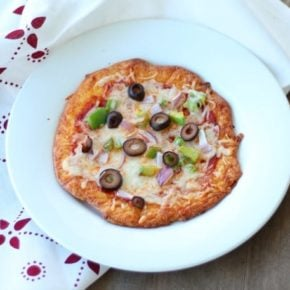 Chewy, low carb pizza crust is easy to make and very filling with just 1.4 net carbs per serving. from lowcarb-ology.com