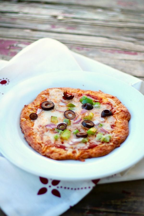 Just 2 net carbs! Low carb pizza crust recipe is quick and easy and has the perfect texture! From Lowcarb-ology.com