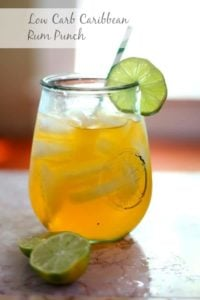 Low carb Caribbean Rum Punch is an Atkins friendly tiki drink with less than 1 carb per serving. SO YUMMY!!! From Lowcarb-ology.com