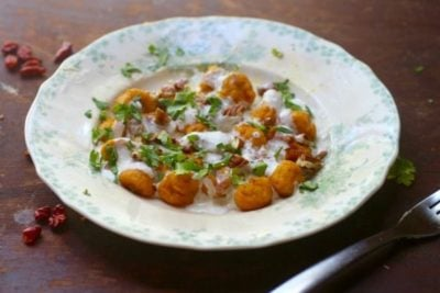low carb pumpkin gnocchi recipe is topped with a spicy crema sauce, pecans, and cilantro. From RestlessChipotle.com