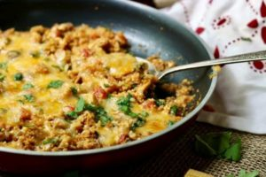 Quick and easy low carb chicken enchilada skillet dinner recipe has just 7 net carbs per serving and it's great for the whole family.